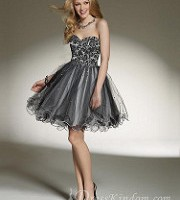 The black color didn't make the homecoming dress lose the sense of cute. Do you agree with me? by dresskindomdeals
